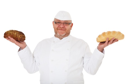 baker's: Charismatic baker holding two kinds of bread Stock Photo