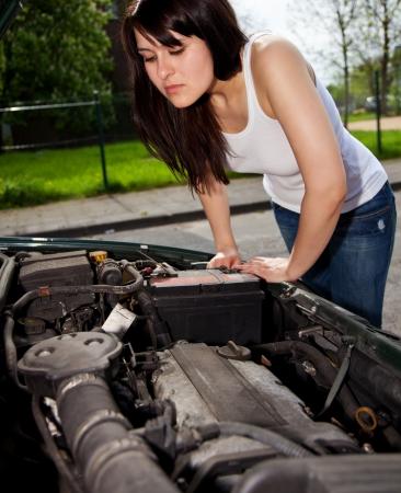 broke: Young woman car broke down