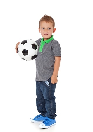 the whole body: Full length shot of a cute little boy holding a soccer ball  All isolated on white background  Stock Photo