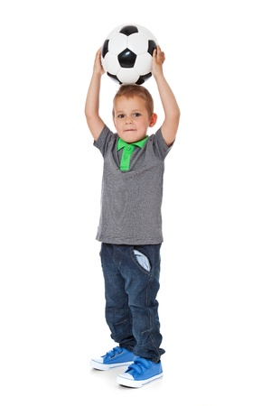 enquiring: Full length shot of a cute little boy playing with a soccer ball  All isolated on white background  Stock Photo