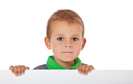 inquisitively: Cute little boy standing behind white wall  All isolated on white background