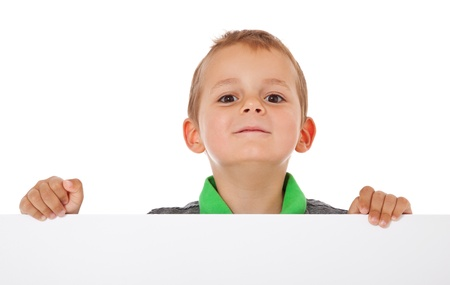 enquiring: Cute little boy behind white wall  All isolated on white background  Stock Photo