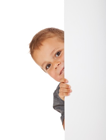 seek: Cute little boy hiding behind a white wall  All isolated on white background