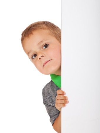 enquiring: Cute little boy hiding behind a white wall  All isolated on white background