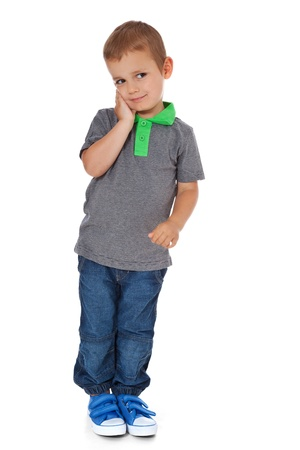 enquiring: Full length shot of a cute little boy deliberating a decision  All isolated on white background