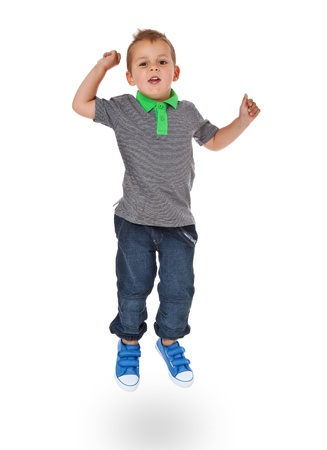 skip: Full length shot of a cute little boy jumping  All isolated on white background  Stock Photo