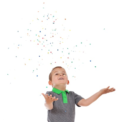 enquiring: Cute little boy having fun with confetti  All isolated on white background  Stock Photo