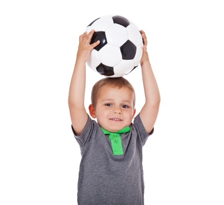 enquiring: Cute little boy playing with a soccer ball  All isolated on white background  Stock Photo