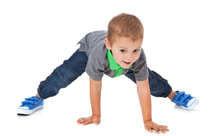 Full length shot of a cute little boy doing sports  All isolated on white background  Standard-Bild