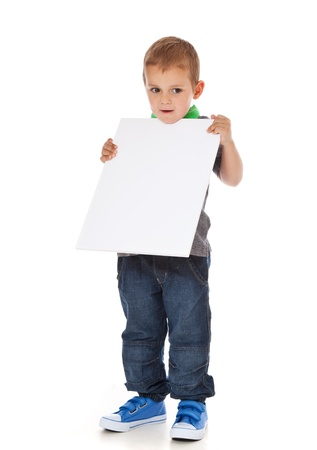enquiring: Full length shot of a cute little boy holding a blank white sign  All isolated on white background  Stock Photo
