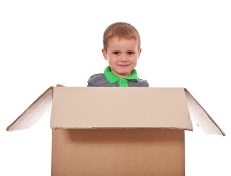 enquiring: Cute little boy sitting in a box  All isolated on white background