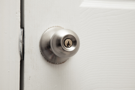 closet door: Closed closet door knob. Plenty of copy space Stock Photo
