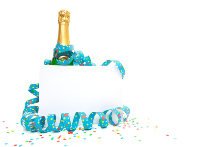 blank sign: Bottle of champagne behind blank sign.