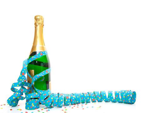 Champagnefles met de partij van gebruiksvoorwerpen Stockfoto