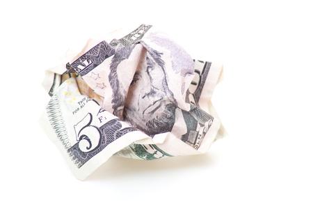 crinkled: Crinkled five US dollar note