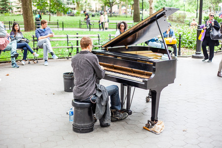 piano player: Piano player in Washington Square Park New York City