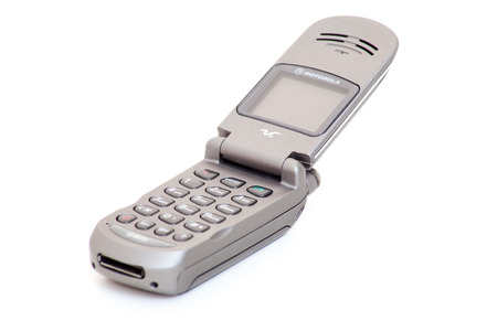 flip phone: Motorola V-Series retro flip phone titan look. All on white background Editorial