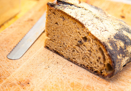 Fresh made bread on wooden board Stock Photo