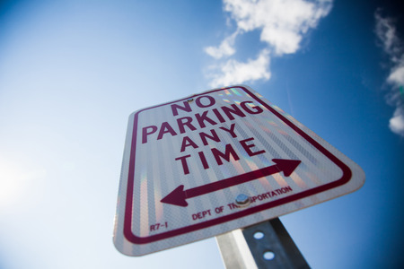parking space: No parking any time sign