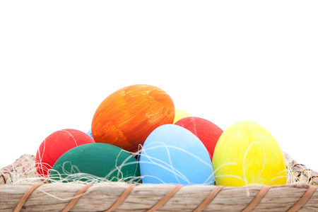 holiday tradition: Easter eggs in basket. All on white background.