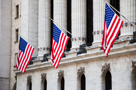 new york stock exchange: Flags of the USA outside the New York Stock Exchange Stock Photo