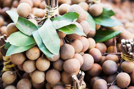 market stall: Fresh longan fruits offered at market stall Stock Photo
