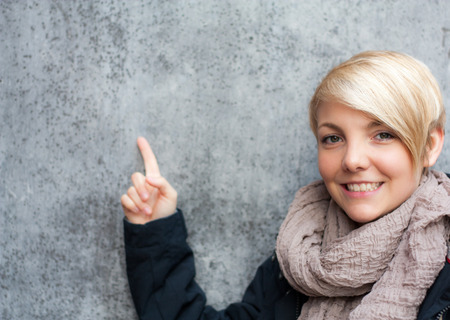 scandinavian people: Attractive young woman pointing with finger