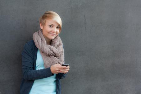 scandinavian descent: Attractive young woman using smart phone