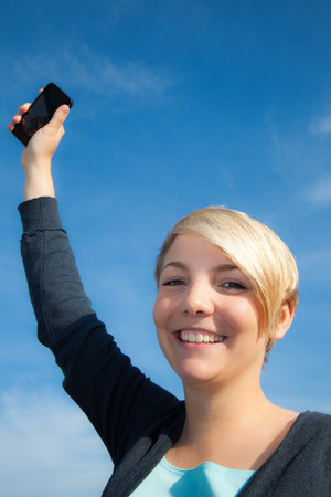 woman on phone: Attractive young woman using smart phone