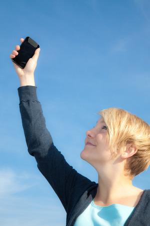 scandinavian people: Attractive young woman using smart phone