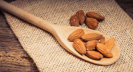 almond: Fine almonds on wooden spoon
