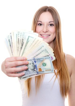 girls youth: Attractive young woman holding us dollar notes. All on white background.