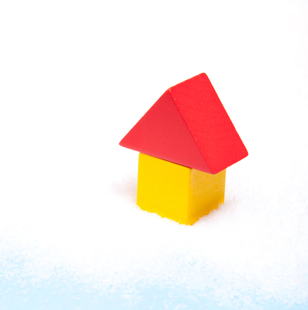 lodgings: Stylized house standing in snow Stock Photo