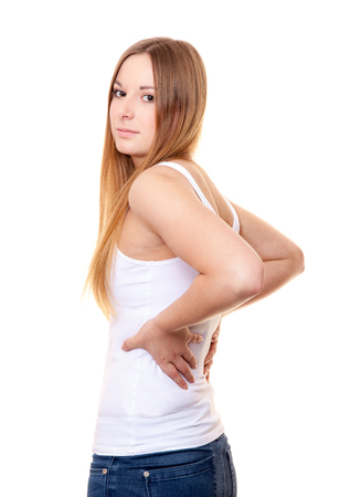 suffers: Attractive young woman suffers from backache. All on white background.