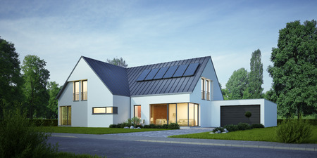 House with solar system in the evening Stockfoto