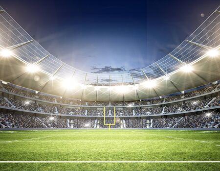 Stadion piłkarski z włączonymi wszystkimi światłami