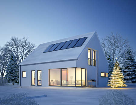 Modern single-family house in a wintry environment Standard-Bild