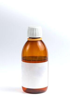 brown vessel with medicine and white label on white background