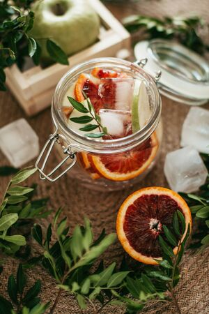 drink in a jar with red orange and ice