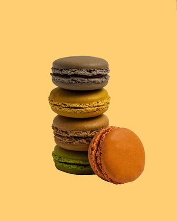 stack of macaroon pastries on a colored background