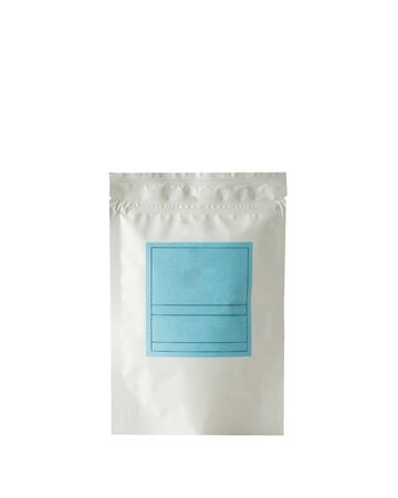 Aluminum bag for tea, coffee, seasonings and other bulk substances with a blue label for signature on a light background close-up. Tea bag isolated on white background.