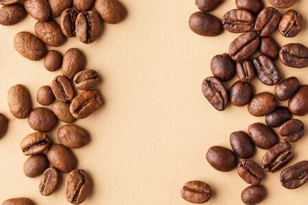 Coffee beans of different varieties on a brown background. For coffee sellers. Horizontal photo with place for text.