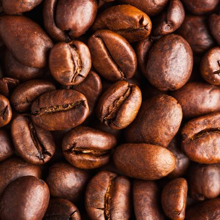 Arabica coffee beans close-up. For screensavers, backgrounds, textures, roasters, and coffee sellers.