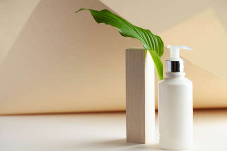 White cosmetic dispenser with space for your logo. Spa concept, skin care. Copy space.