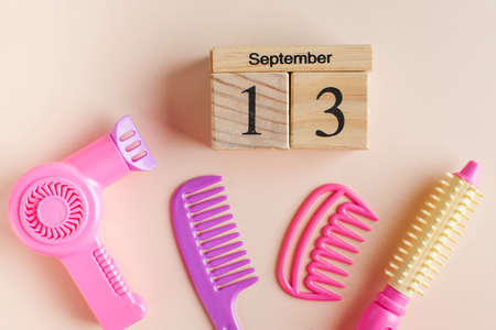 A wooden calendar for September 13 and a toy set for the Barber. The day of the hairdresser. High quality photo