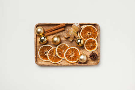 Christmas card with gingerbread man, cinnamon, dried orange slices and Christmas toys. Copy space.