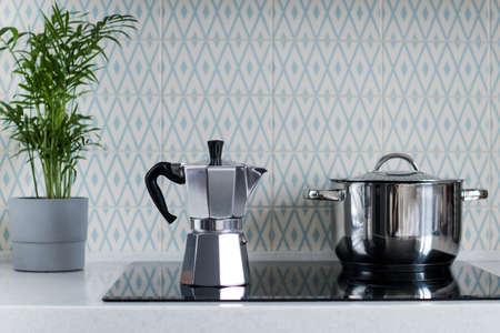 Silver moka coffee pot on the kitchen stove. Geyser coffee machine. Copy space. Reklamní fotografie