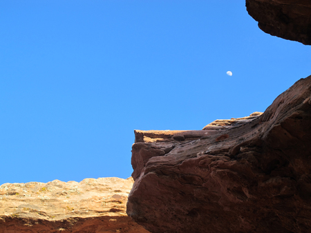 Clear Blue  Sky Framed by Southwest United States Desert Cliffs and Rocky Overhangs