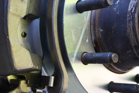 Bolts of a wheel hub with newly replaced caliper, rotor and brake pads Stock Photo