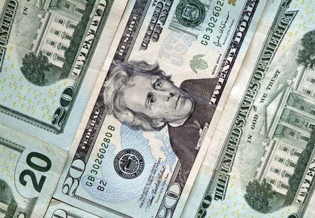 smacker: several flat twenty dollar bills background